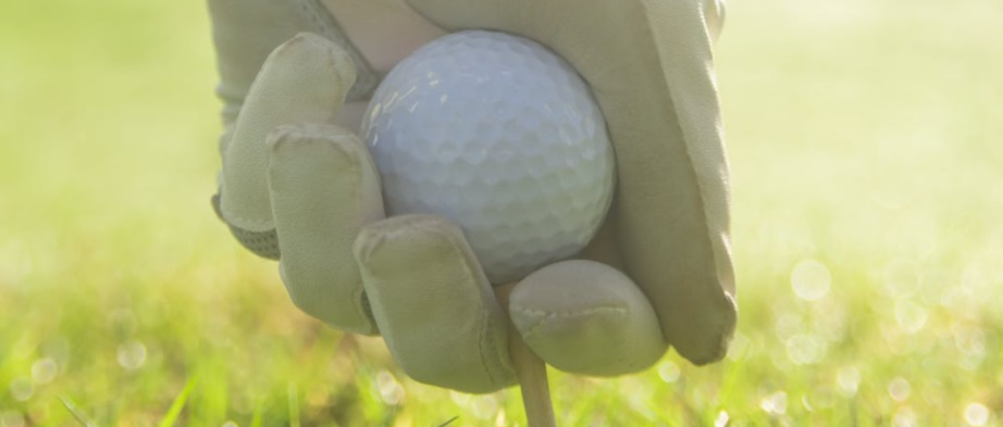 setting up to drive a golf ball